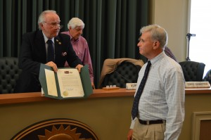Mayor H. Ford Gravitt presents Van McCollum with a proclamation honoring his service to the Cumming Playhouse during the April 21 City Council meeting.