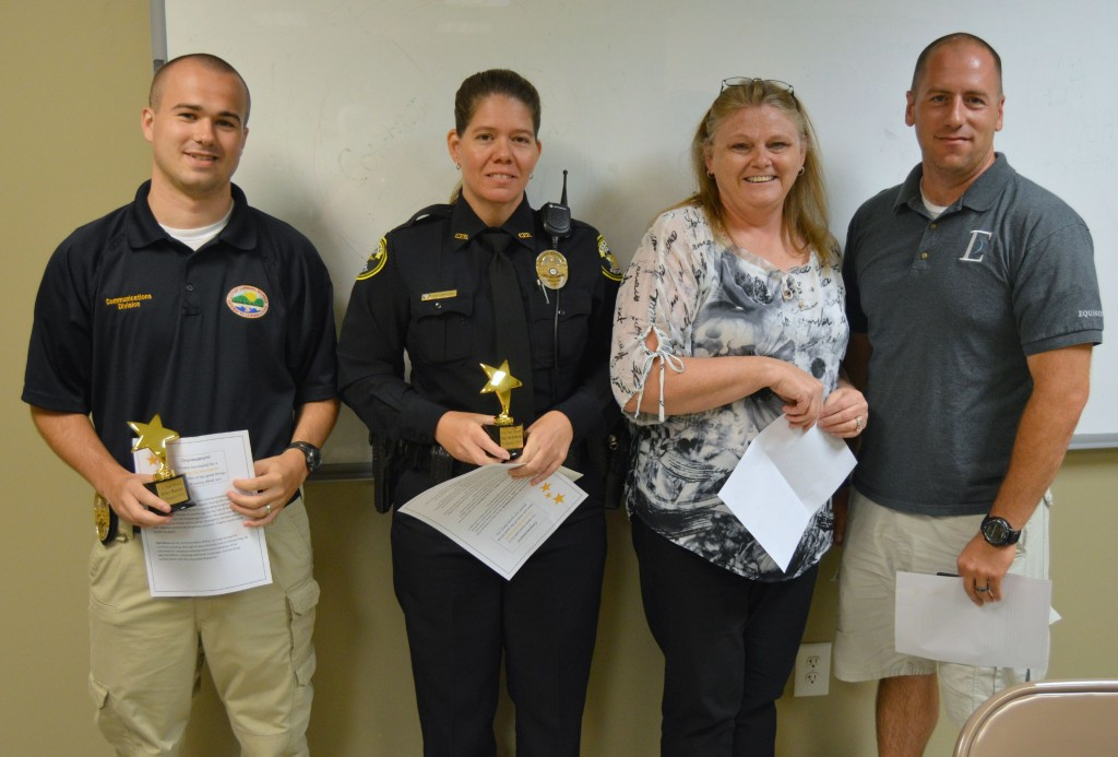Photo captions – Police Department, from left, Tyler Burns, Tracy See-Holbrook, Jennifer Parker and Nathan VanBuren. Nominees not pictured: Burrell Sullivan and Benjamin Haack.